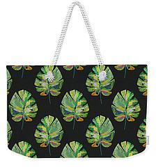 Weekender Tote Bag featuring the mixed media Tropical Leaves On Black- Art By Linda Woods by Linda Woods