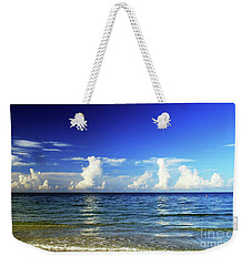 Weekender Tote Bag featuring the photograph Tropical Storm Brewing by Gary Wonning