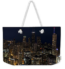 Weekender Tote Bag featuring the photograph Trump Hotel by Andrea Silies