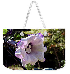 Weekender Tote Bag featuring the photograph Trumpet Flower by Melissa Messick