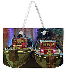 Weekender Tote Bag featuring the photograph Tug Boats At Night by Frozen in Time Fine Art Photography