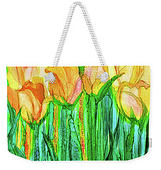 Weekender Tote Bag featuring the mixed media Tulip Bloomies 1 - Yellow by Carol Cavalaris