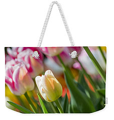 Weekender Tote Bag featuring the photograph Tulips by Angela DeFrias