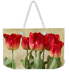 Weekender Tote Bag featuring the photograph Tulips by Ann Jacobson