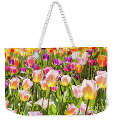Weekender Tote Bag featuring the photograph Tulips  by Charles Garcia