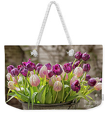 Weekender Tote Bag featuring the photograph Tulips In A Bucket by Patricia Hofmeester