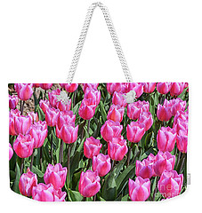Weekender Tote Bag featuring the photograph Tulips In Pink Color by Patricia Hofmeester