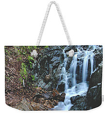 Weekender Tote Bag featuring the photograph Tumbling Down by Laurie Search