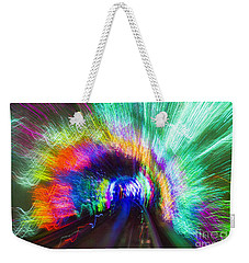 Weekender Tote Bag featuring the photograph Tunnel Lights by Angela DeFrias