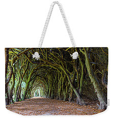 Weekender Tote Bag featuring the photograph Tunnel Of Intertwined Yew Trees by Semmick Photo