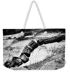 Weekender Tote Bag featuring the photograph Turned To Stone by Paul W Faust - Impressions of Light