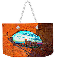 Weekender Tote Bag featuring the photograph Turret Arch Through Window by Norman Hall