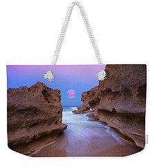Weekender Tote Bag featuring the photograph Twilight Moon Rising Over Hutchinson Island Beach Rocks by Justin Kelefas