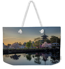 Weekender Tote Bag featuring the photograph Twilight Temple by Rikk Flohr