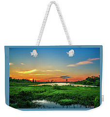 Weekender Tote Bag featuring the photograph Twilights Arrival by Marvin Spates