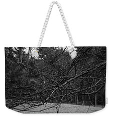 Weekender Tote Bag featuring the photograph Twisted And Wet by Angie Tirado