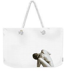 Weekender Tote Bag featuring the photograph Twisted Figure On White by Rikk Flohr
