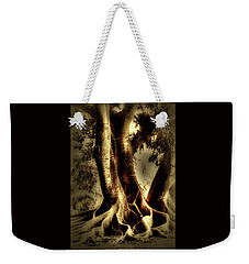 Weekender Tote Bag featuring the photograph Twisted Trees by Tom Prendergast