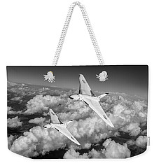 Weekender Tote Bag featuring the photograph Two Avro Vulcan B1 Nuclear Bombers Bw Version by Gary Eason