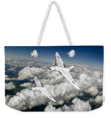 Weekender Tote Bag featuring the photograph Two Avro Vulcan B1 Nuclear Bombers by Gary Eason