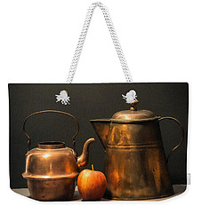 Weekender Tote Bag featuring the photograph Two Copper Pots And An Apple by Frank Wilson