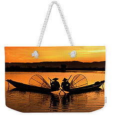 Weekender Tote Bag featuring the photograph Two Fisherman At Sunset by Pradeep Raja Prints