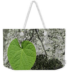 Weekender Tote Bag featuring the photograph Two Hearts Entwined by Bruce Carpenter