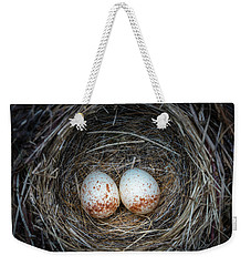 Weekender Tote Bag featuring the photograph Two Junco Eggs In The Nest by William Lee