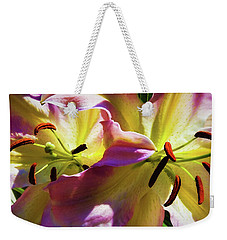 Weekender Tote Bag featuring the photograph Two Lilies by Jessica Manelis