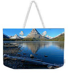 Weekender Tote Bag featuring the photograph Two Medicine Drift Log by Adam Jewell