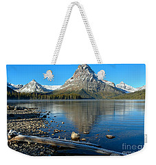Weekender Tote Bag featuring the photograph Two Medicine Driftwood by Adam Jewell