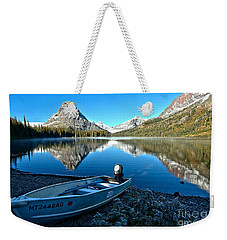 Weekender Tote Bag featuring the photograph Two Medicine Motorboat by Adam Jewell