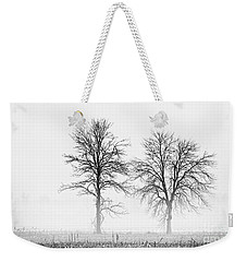 Weekender Tote Bag featuring the photograph Two... by Nina Stavlund