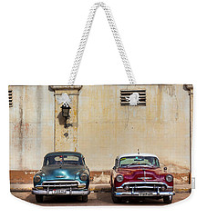 Weekender Tote Bag featuring the photograph Two Old Vintage Chevys Havana Cuba by Charles Harden