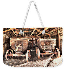 Weekender Tote Bag featuring the photograph Two Old Wagons by Jeff Swan