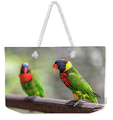 Weekender Tote Bag featuring the photograph Two Parrots by Pradeep Raja Prints