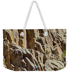 Weekender Tote Bag featuring the photograph Two Rock Climbers Making Their Way by James BO Insogna