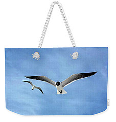 Two Seagulls Against A Blue Sky Weekender Tote Bag