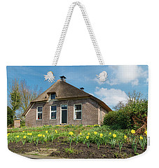 Weekender Tote Bag featuring the photograph Typical Dutch House by Hans Engbers