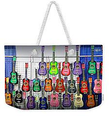 Weekender Tote Bag featuring the photograph Ukuleles At The Fair by Lori Seaman