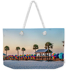 Weekender Tote Bag featuring the photograph Umbrella Windbreaks At Clearwater Florida. by Brian Tarr