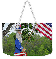 Weekender Tote Bag featuring the photograph Uncle Sam Patriotic Flag by Betty Denise