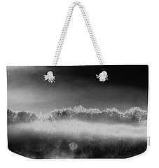 Weekender Tote Bag featuring the photograph Under A Cloud by Steven Huszar