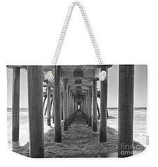 Weekender Tote Bag featuring the photograph Under Huntington Beach Pier by Ana V Ramirez