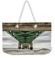 Weekender Tote Bag featuring the photograph Under Mackinac Bridge Winter by John McGraw