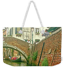 Weekender Tote Bag featuring the photograph Under The Bridge by Anne Kotan