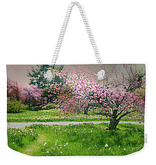 Weekender Tote Bag featuring the photograph Under The Cherry Tree by Diana Angstadt