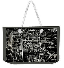 Weekender Tote Bag featuring the photograph Under The Hood by Jeffrey Jensen
