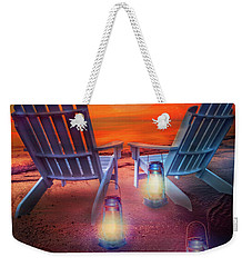 Weekender Tote Bag featuring the photograph Under The Moon by Debra and Dave Vanderlaan