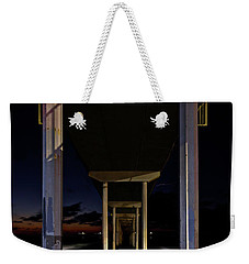 Weekender Tote Bag featuring the photograph Under The Ocean Beach Pier At Sunste by James Sage
